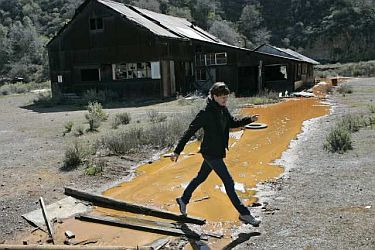 Abandoned mercury mine sending polluted, orange waste into creek.