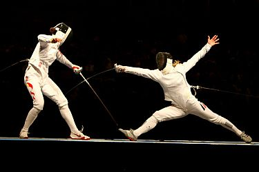 Fencing - Li Na of China competes against Britta Heidemann.