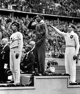 Jesse Owens on the podium in 1936 Summer Olympics in Berlin.