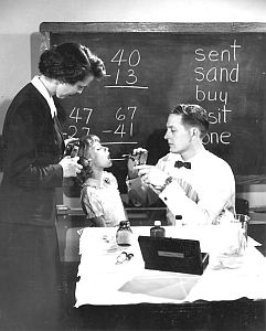 Vintage Photo: Doctor examining child's throat.